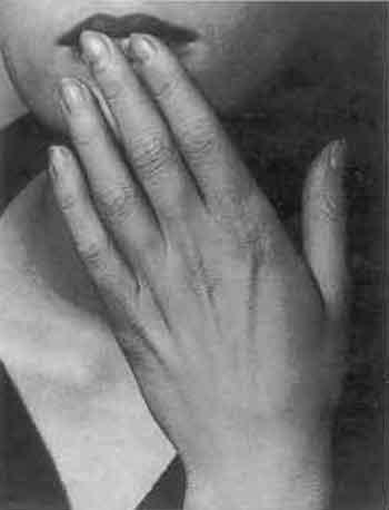 Hand on lips
